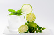 Limes, refreshing drink with ice