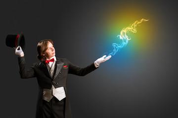 magician produces multicolored smoke