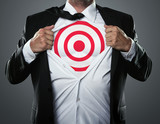 Young businessman tearing his shirt off to show target symbol