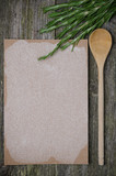 Blank paper with space for text, spoon and fresh rosemary