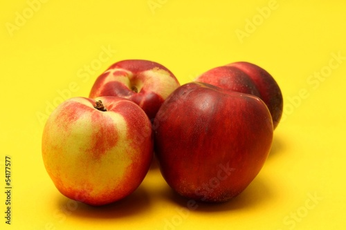 Nectarines on colored background