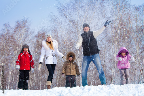 Family in winter parkl