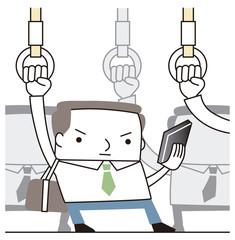 通勤中スマートフォンをみるビジネスマン