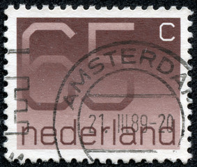 stamp printed in the Netherlands shows numeral ordinary gum
