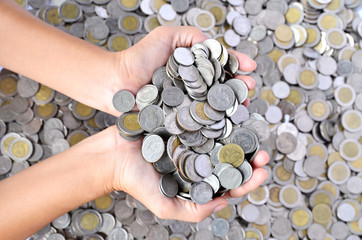 a lot of coins in hands