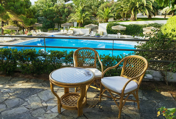 table and chairs for rest overlooking the pool
