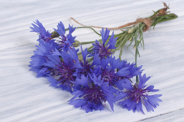 Wild flowers of the field cornflowers on the table