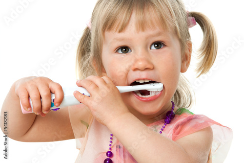 Close up portrait of cute girl brushing teeth.