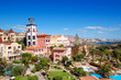 Tower with clock and swimming pool at the luxury hotel, Tenerife