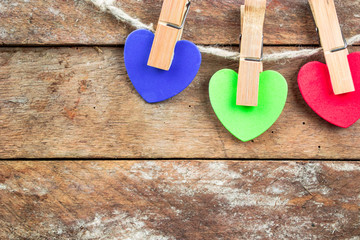 Colored hearts on wooden background