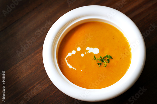 Carrot and yam creamy soup with cream and thyme, appetizer