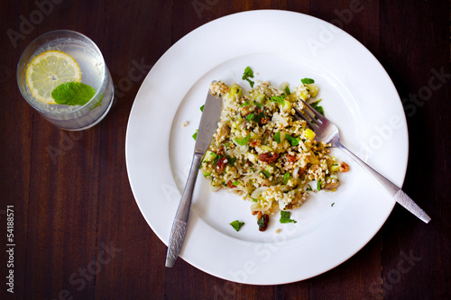 Millet cereal salad with avocado, cucumber and raisins, lemonade