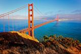 Fototapety Golden Gate Bridge mit Hügel im Abendlicht - San Francisco