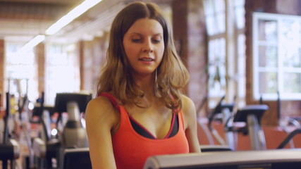 HD720p50 Young woman exercising at a gym.