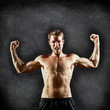 Crossfit fitness man flexing strong on blackboard