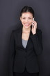 Businesswoman talking on smart phone happy