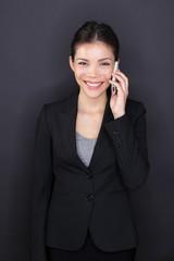 Businesswoman talking on smart phone happy