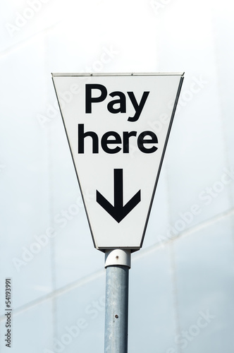 Pay Here sign in a Pay and display carpark