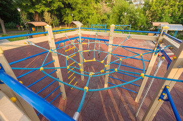 Blue spider net construction on kids playground