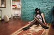 Crime scene simulation: lifeless brunette on the floor