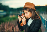 Beautiful hipster girl shooting