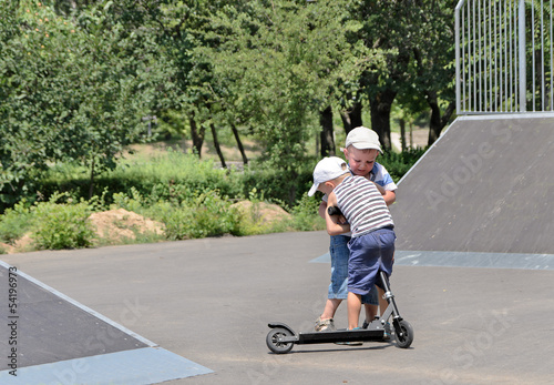 Two brothers fighting over a scooter
