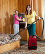 Women are cleaned with vacuum cleaner