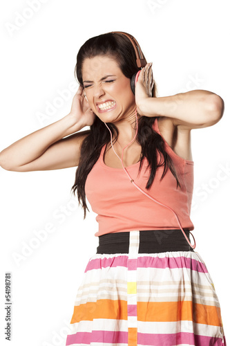 girl with painful grimace due to high volume of music