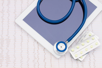 blue stethoscope with medical tablet