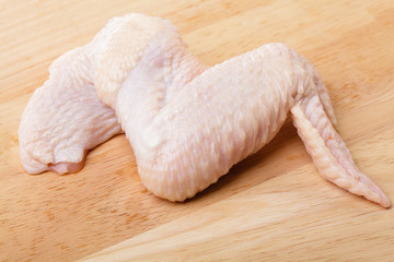 raw chicken wings on wood