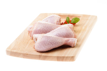 raw chicken legs on wood