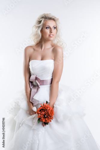 Charming young bride in elegant dress, close-up