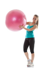 Funny girl posing in sportswear with pink ball
