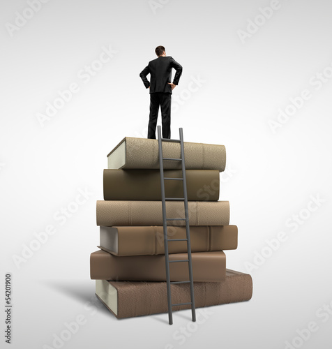 businessman standing on books