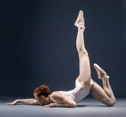 Image of flexible ballerina dancing in studio