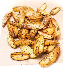 Fried potato wedges country styled  on  kraft paper. Fast food.
