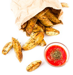 French fries potato wedges with hot red  sauce in recycled kraft