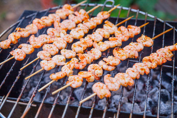 delicious prawn spit on grill