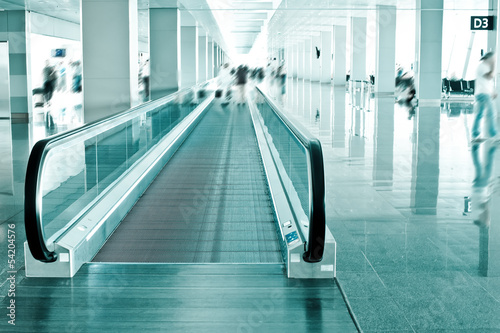 Travel concept. Escalator inside modern airport terminal