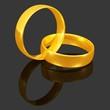ineinanderliegende goldene Eheringe