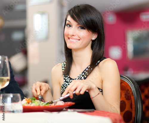 Woman having a dinner at the restaurant