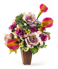 Bouquet of rose and lily in wood bucket