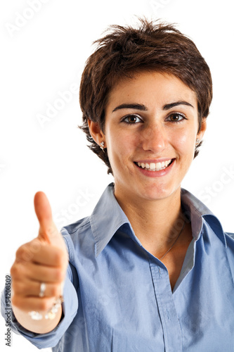 Smiling businesswoman thumbs up
