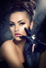 Beauty Fashion Girl Portrait. Vintage Style Girl Wearing Gloves