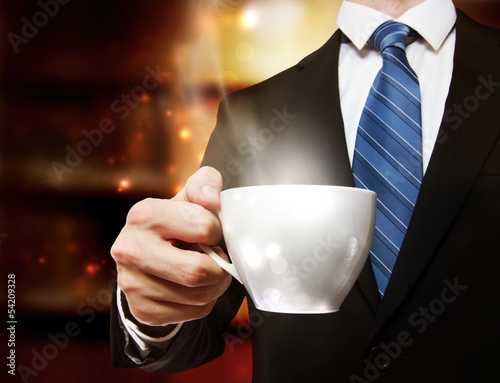 Business Man Holding a Cup of Coffee