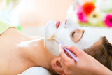 Fototapety Wellness - woman getting face mask in spa