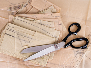Dressmaking pattern and scissors, background