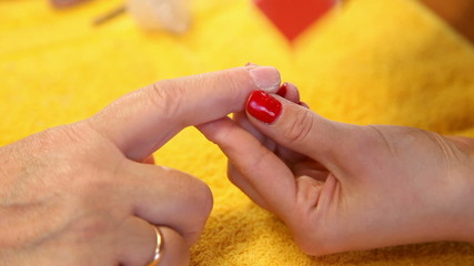 Visagist making manicure to a model. Close-up.
