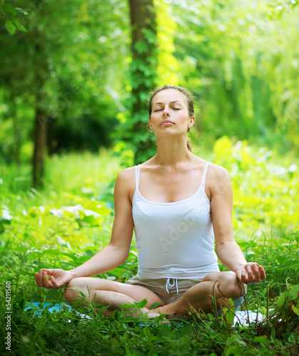 Yoga. Young woman doing yoga exercise outdoor