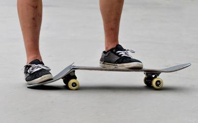 skateboarder with a broken skateboard